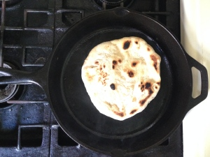Flip over the naan to brown both sides